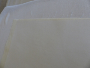Pressing freezer paper sheet to fabric