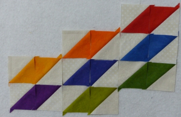 Rainbow half-square triangles