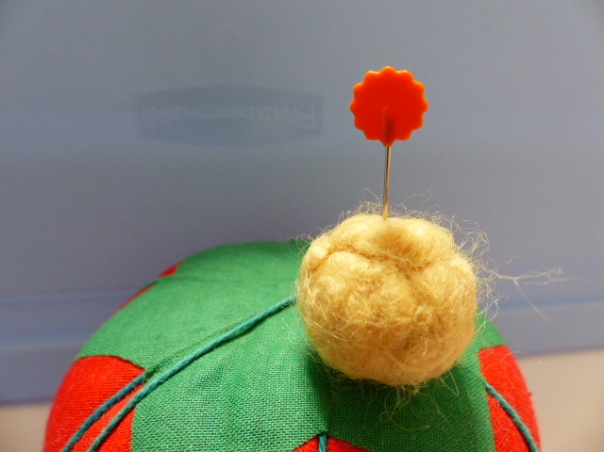 Anchoring felted ball